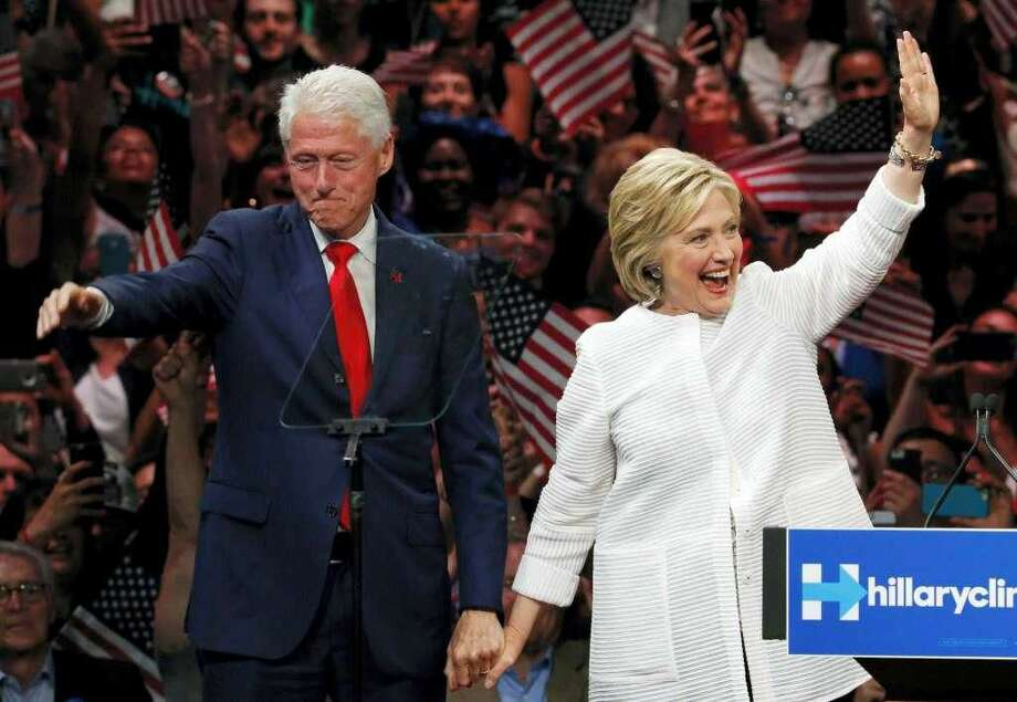 In this Nov. 8, 2016, file photo, Democratic presidential candidate Hillary Clinton, and her husband former President Bill Clinton, greet supporters after voting in Chappaqua, N.Y.