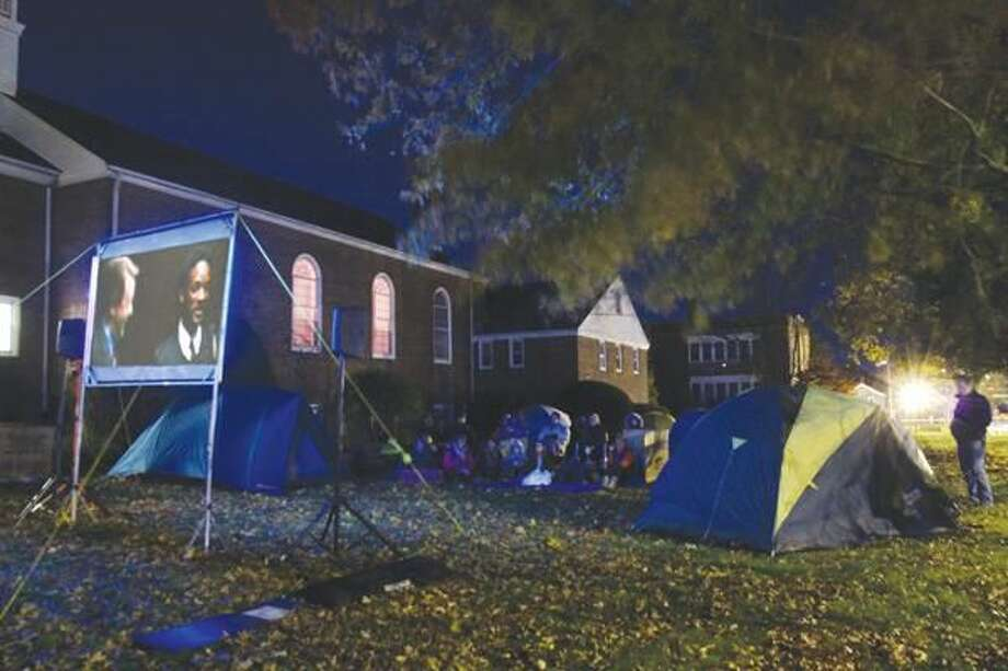 """Submitted photo by Matt Lincoln Young people and adults from North Haven Congregational Church and St. John's Episcopal Church created a """"tent city"""" on the lawn of the Congregational church Wednesday night, Nov. 10, to raise awareness of the plight of the homeless and raise funds to support Abraham's Tent, a program of Columbus House in New Haven."""