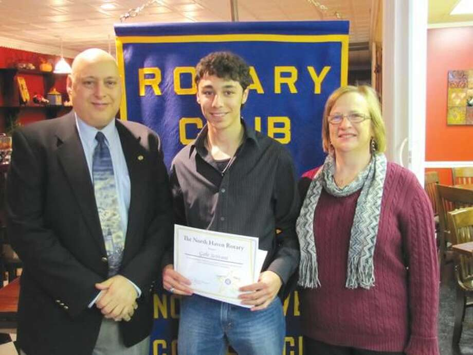 Submitted photos by Rotary Secretary David Marchesseault Rotary President Rick DiNorscia and Bernadette Casella recognize Unsung Hero Gabe Scrivani.