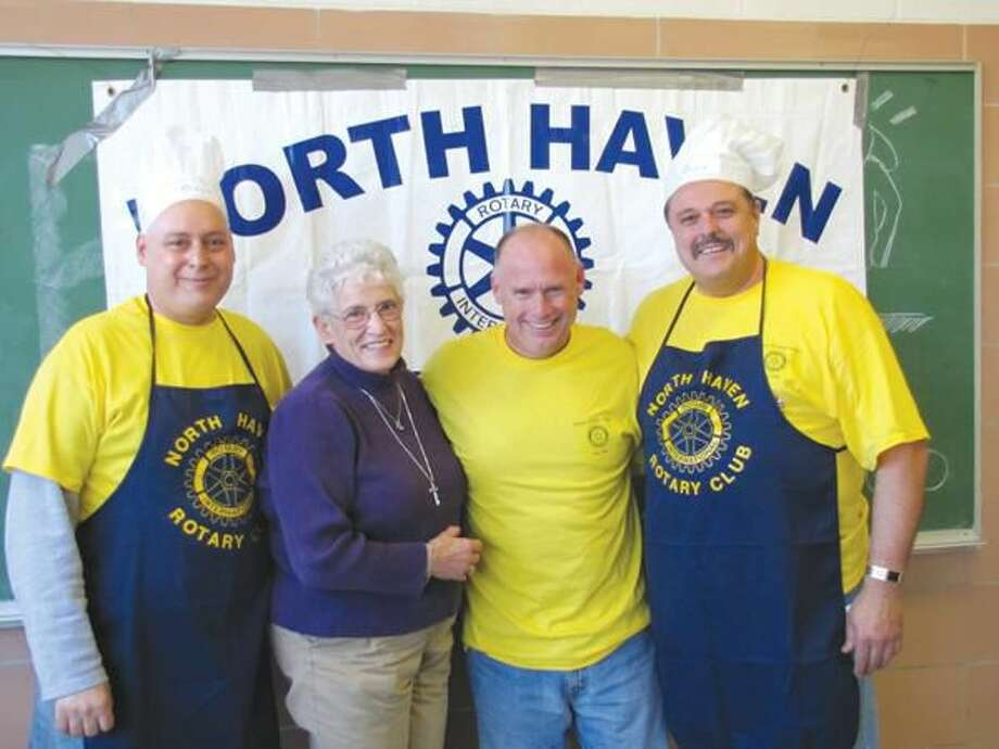 Submitted Photo by David Marchesseault, Rotary Club Secretary Club President Rick DiNorscia, District Governor Julie Reppenhagen, Assistant Governor Rick Bassett, and President-Elect Guy Casella posed.