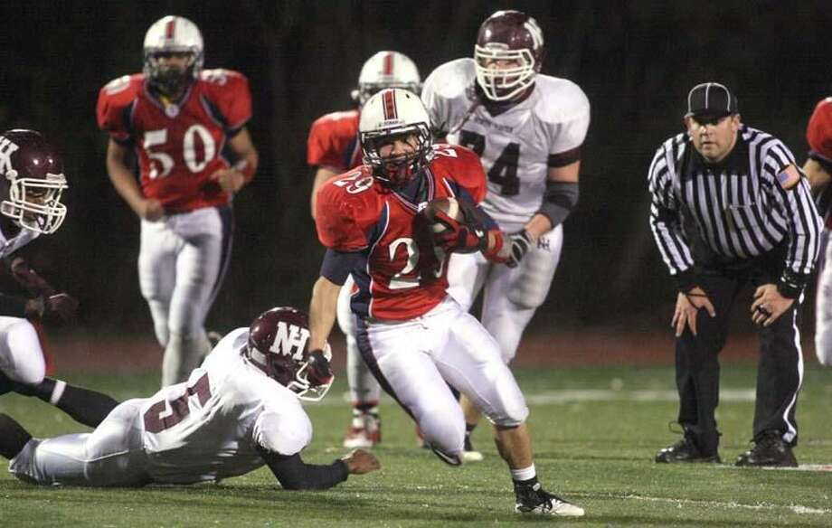 Photo by Russ McCreven Foran's Andrew Sileo runs through the North Haven defense.