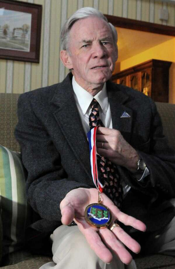 Photo by Brad Horrigan Abner Oakes, a US Navy veteran from Hamden, has been named to the Connecticut Veterans' Wall of Fame. Here, Oakes holds his medal from the ceremony.