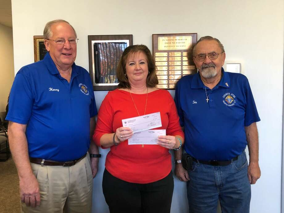 From left, Harry Bahls, Grand Knight of the North Haven Knights of Columbus; Jackie Paul, Business Manager of The Vantage Group (ARC); and Stu Lyon, Past Grand Knight of the North Haven Knights of Columbus.