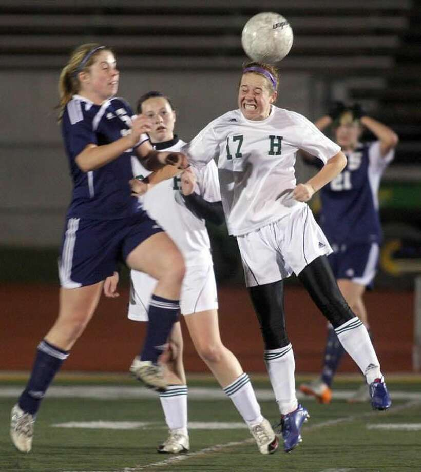 Photo by Russ McCreven Hamden's Rachel Dowe heads the ball against Staples in the quarterfinal round of Class LL state tournament.