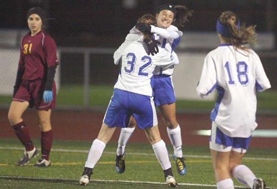 Photo by Russ McCreven West Haven's Gabriela Reis gets a hug from Ashley Hulse after scoring a goal in the Westies' 5-2 win over Sheehan in Saturday night's season finale at Ken Strong Stadium.