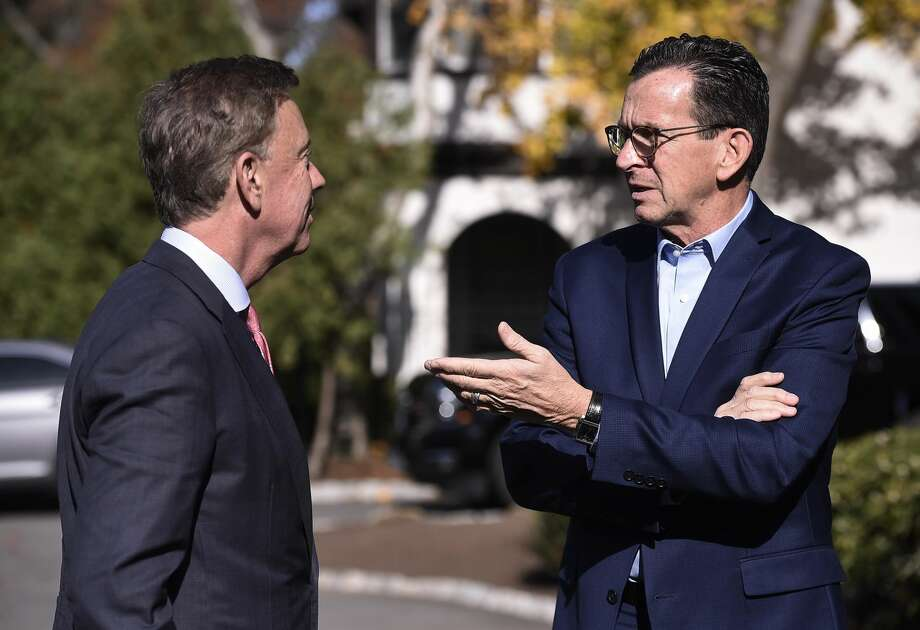 Gov. Dannel P. Malloy, right, talks with Connecticut's governor-elect Ned Lamont at the governor's residence in Hartford on Nov. 8.