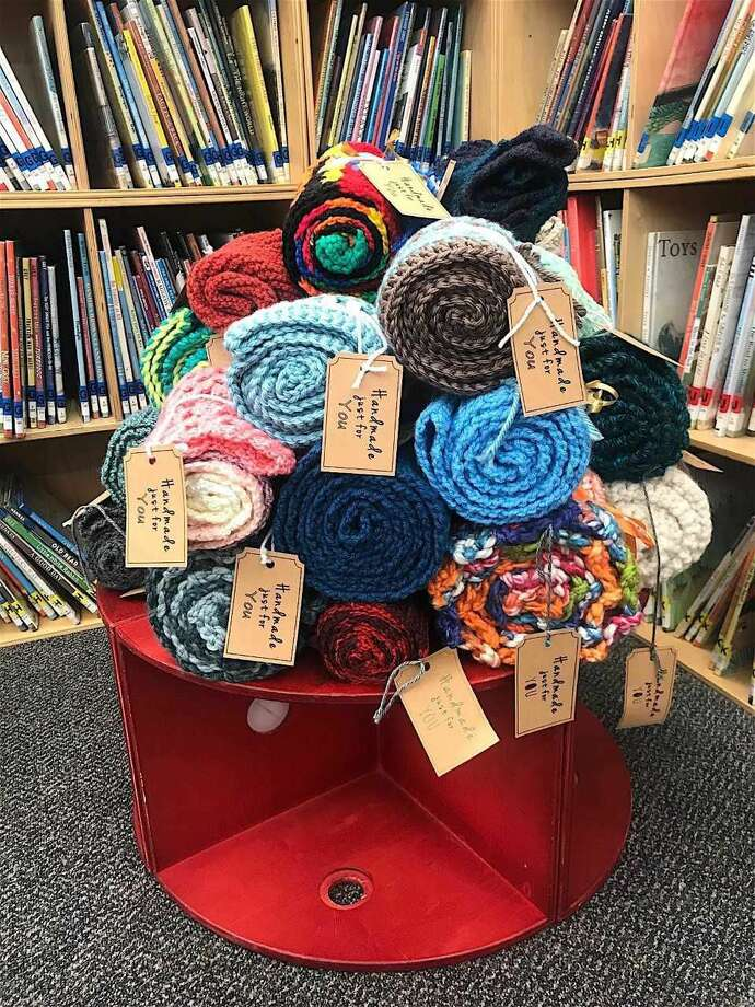 """Knitted creations at Hamden Library with cards saying, """"Handmade just for you."""""""
