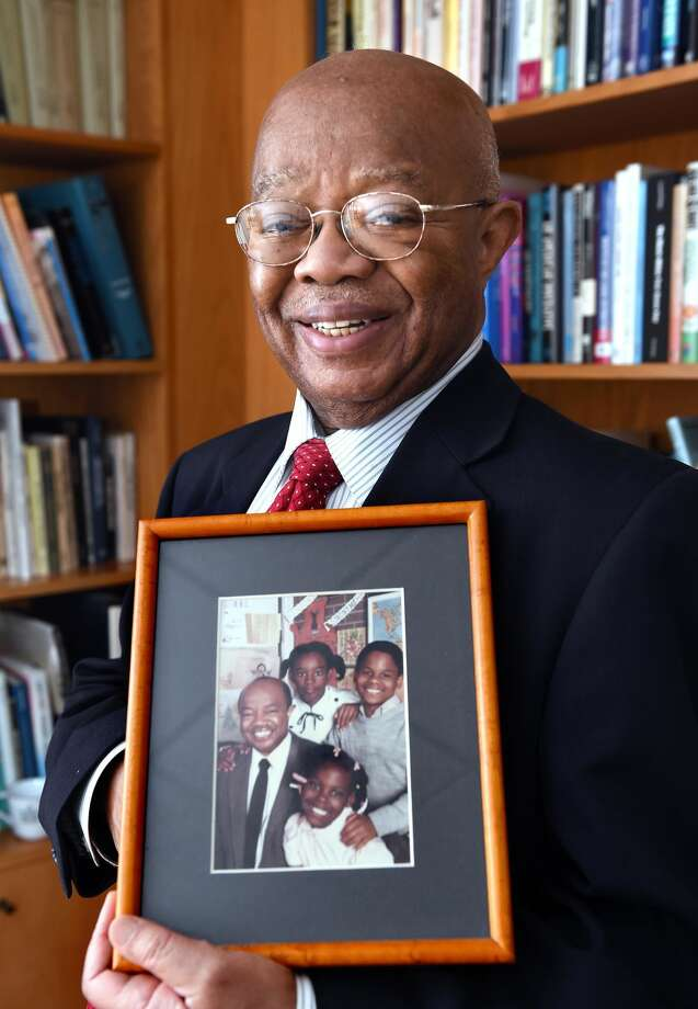 Dr. James Comer of the Yale Child Study Center is photographed on Oct. 29 holding an old picture taken with students at the former Martin Luther King Jr. Elementary School in New Haven.
