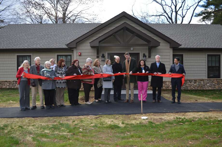 The ribbon-cutting ceremony at the MoraLee Guest Cottages.
