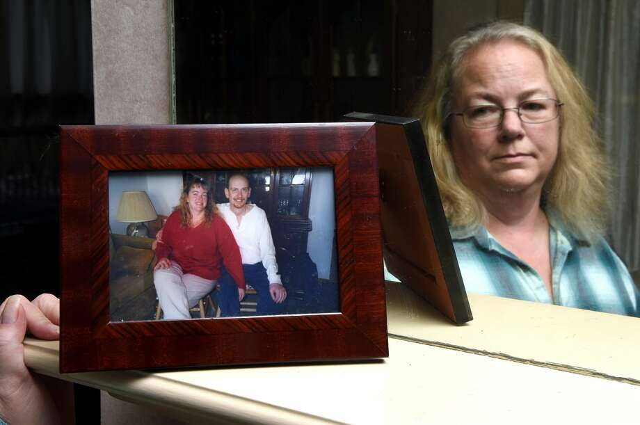 Susan Tendler looks at a photograph of her deceased husband, Harris, and herself at her home in Hamden. Harris was killed on December 11, 2016 when he was hit by a car on Dixwell Avenue.