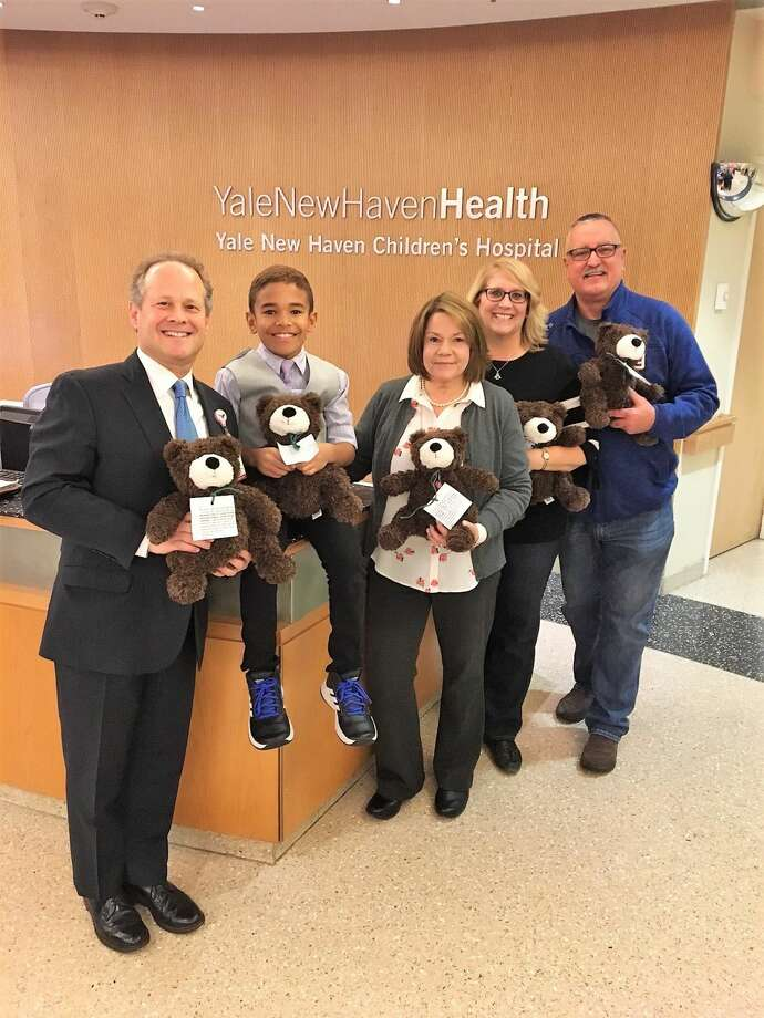 Gathering at Yale New Haven Childrens Hospital to receive the 36 teddy bears are, from left to right, Dr. Alan Friedman, Jayden Cooper, Nancy Cross, RN, Bethany Seefeldt and Charlie Seefeldt.