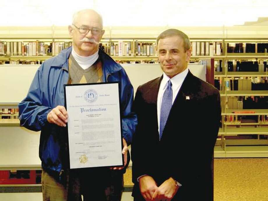 Submitted photo by Frank Laudano First Selectman Michael Freda, left, honors long time resident and retired business owner, John Graef, Thursday, Nov. 18.