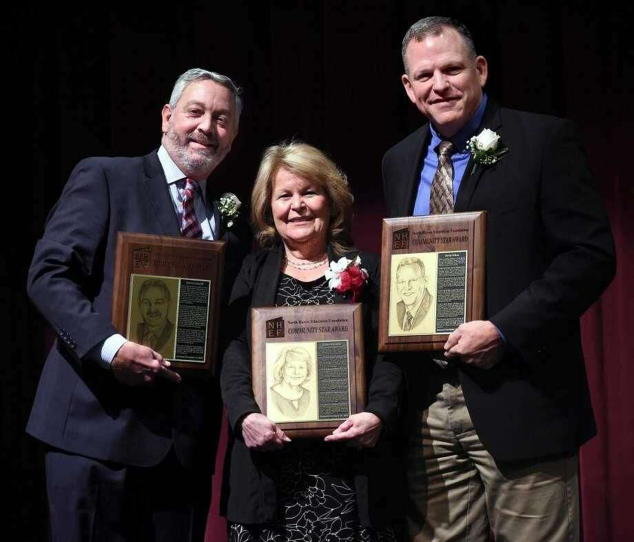 From left, Larry Lazaroff, Linda Battalene and David Mikos with their Community Star Awards from the North Haven Education Foundation at North Haven Middle School.