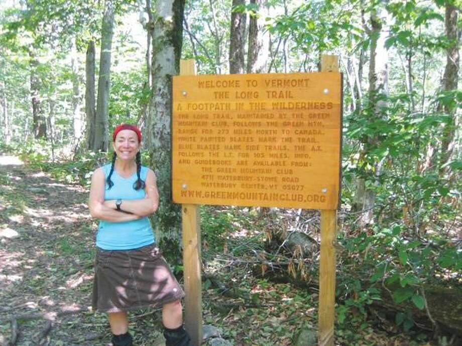 Submitted Photo Hamden resident Leona Harberg takes a moment to pose at the start of Vermont's Long Trail in September. Harberg hiked 165 miles of the trail to fundraise for her friend Nancy Cusick, of Hamden, who was diagnosed with multiple sclerosis in 2008. Harberg, who dubbed her hike, Heading North For Nancy, has currently raised more than $7,100 for the National MS Society, Connecticut Chapter.