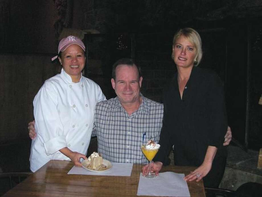 Photo by Lynn Fredricksen Scott Weins, one of the owners of the Rustic Oak Restaurant is flanked by his wife and head chef Susan Weins and bartender Jennifer D'Errico. Susan Weins' Harvest Pie dessert inspired D'Errico's creation, Autumn Harvest Martini.
