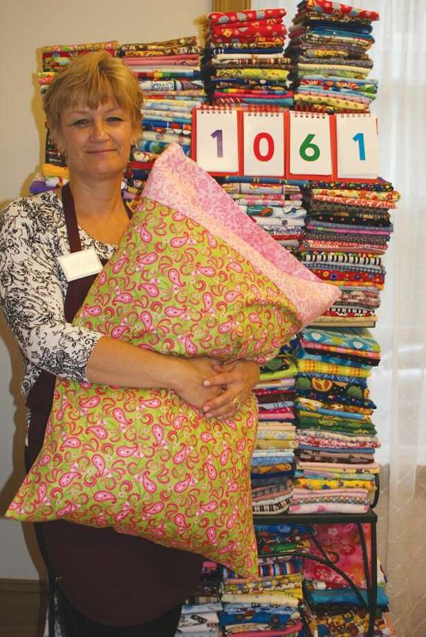 Photo by Christine Firth Nancy Trunko, owner of Yankee Cloth quilt shop in Wallingford displays over 1000 pillowcases to be donated to local charities.