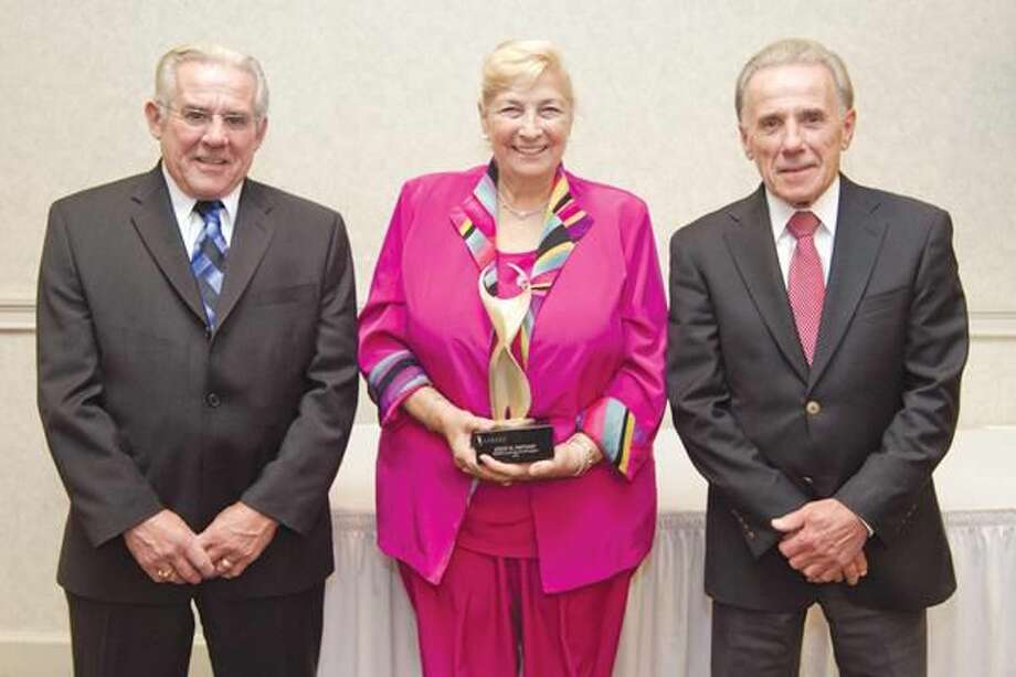 Submitted photo compliments of Lifetiled Event presenters Tony and Bob DeBaise of Robert's Chryslers Dodge, with Recipient Joyce Saltman.