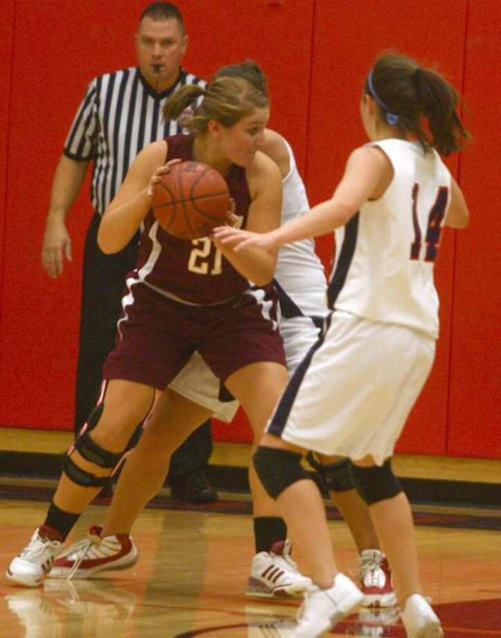 Photo by Russ McCreven Sheehan's Rachel Collette looks to make her move past the Foran defense in the Titans' 40-38 victory.