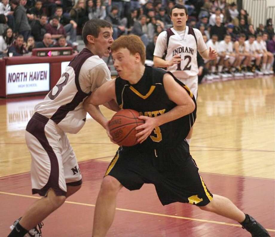 Photo by Russ McCreven Amity's Pat Sasso works his way inside against North Haven.