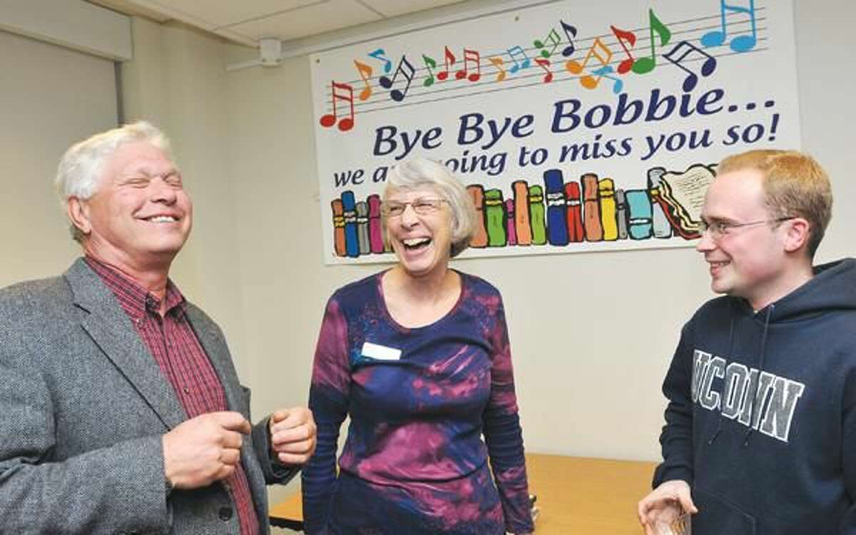 Photo by Peter Casolino Wallingford librarian Bobbie Borne shares a laugh with Ed Scherer (left) of Weathersfield and Seth Voytek of Wallingford, during a retirement party for Borne. Borne is retiring after 20-years of working at the reference desk and serving the teenage population at the library. Voytek, a long-time library user, has known Borne most of his life. Scherer is the husband of the library's director.