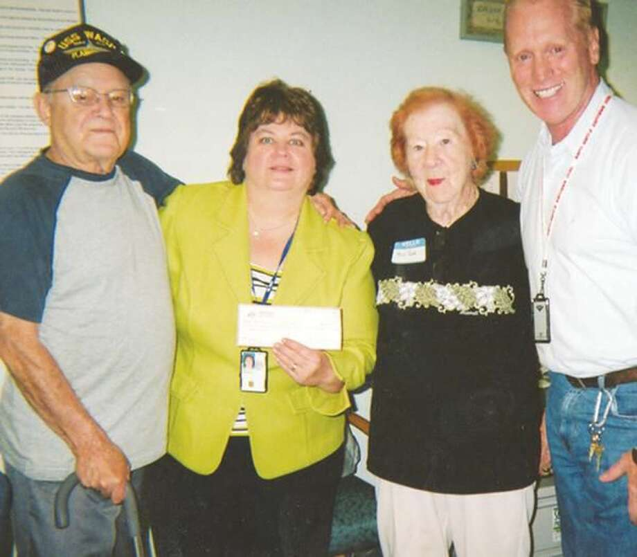 Submitted Photo Don Tozzo and Jane Park, Hamden Elks Veterans Co-chairs, present a $2,000 donation to Bernadette Kern of the Patient Advocate Office and Mike Rose, Chief of Recreation & Creative Arts Therapy at the West Haven Veteran's Hospital.