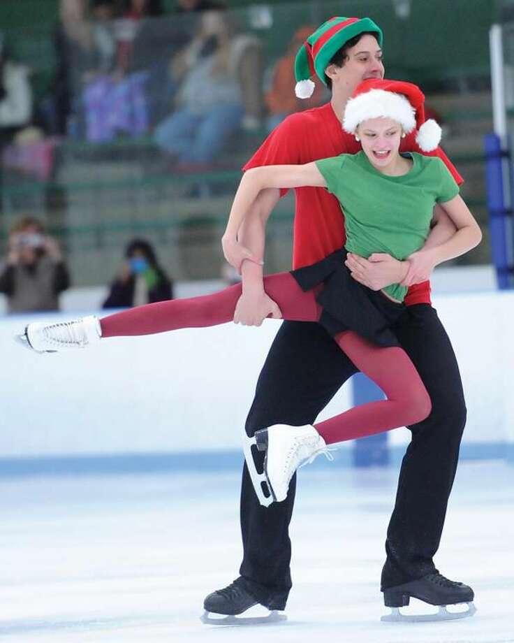 Photo by Brad Horrigan Max Kruger-Dull and Susannah Frank skate pairs at the Hamden Figure Skating Holiday Exhibition at Astorino Rink Sunday.