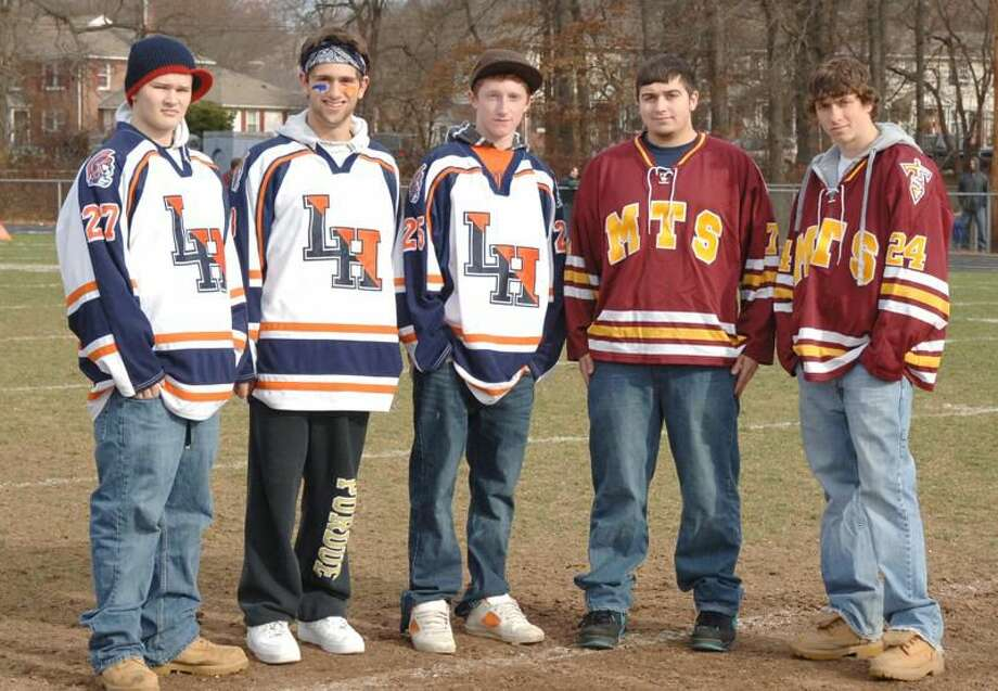 Photo by Ray Yanagisawa Lyman Hall hockey captains (from left to right) Everett Bolduc, Adam McKay, Patrick Reynolds and Sheehan's Vincent Esposito (left) and Nick Capozzi will lead their respective teams into the 2010-11 season.