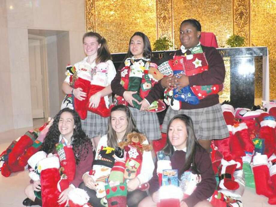 Submitted photo by Elizabeth Christophy The Student Council Executive Board coordinated the Annual Stocking Drive. Pictured are: back row: Erin Hillis of Derby (appointed member), Lauren LaChance of Seymore (president), and Brianna Coley of Hamden (vice president); front row: Elizabeth Tomanio of West Haven (treasurer), Kellie Mason of Hamden (appointed member), and Nicole Sroka of Derby (secretary).