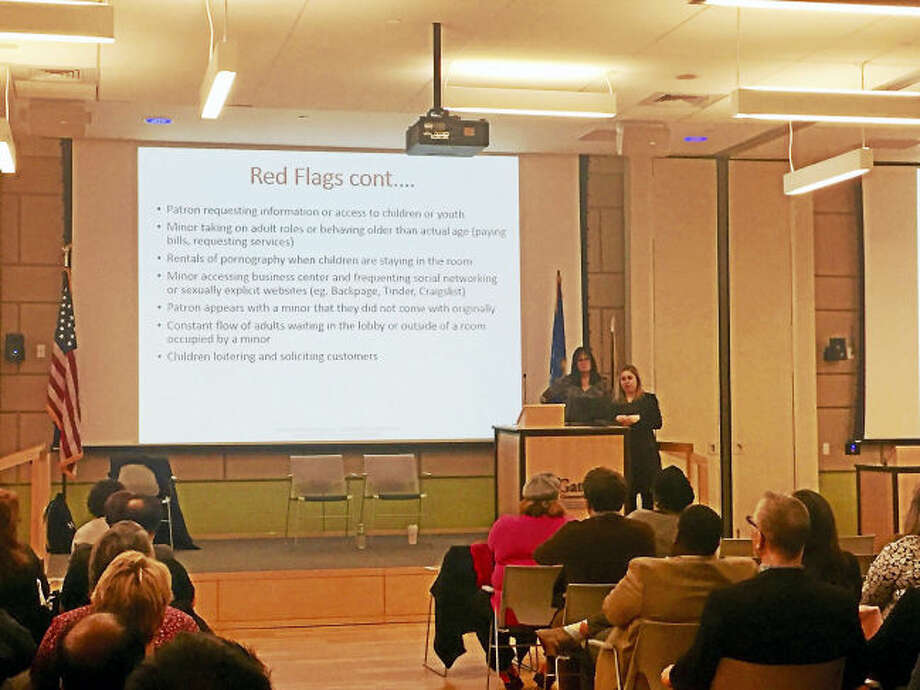 Erin Williamson, survivor care coordinator for Love146, gives a presentation on the warning signs of human trafficking at Gateway Community College Thursday. (Anna Bisaro - New Haven Register)