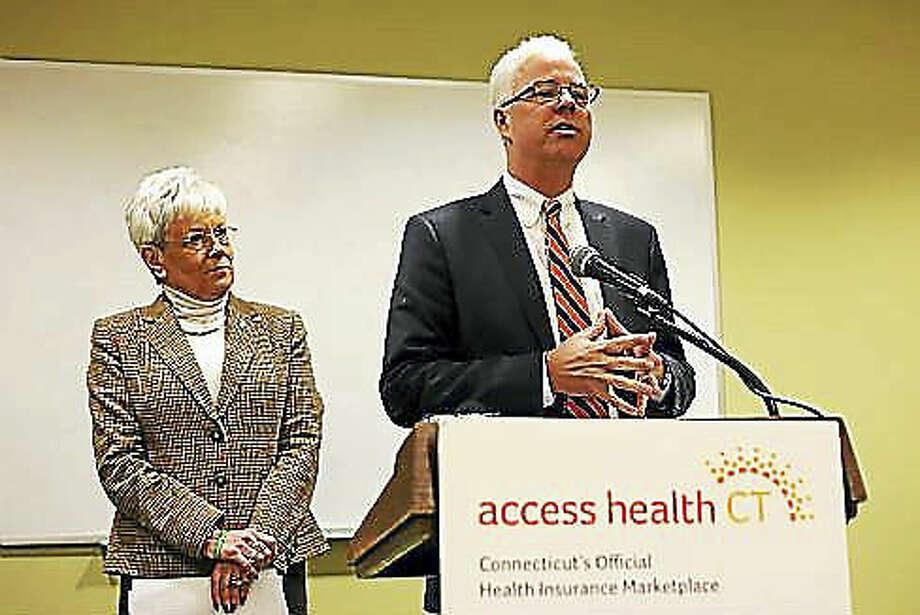 Access Health CT CEO Jim Wadleigh speaks at the podium. In rear is Lt. Gov. Nancy Wyman