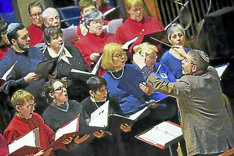 "Catherine Avalone — New Haven Register The Combined Interfaith Choir performs ""This Little Light of Mine"" at the annual interfaith service in tribute to the Rev. Martin Luther King Jr. on Friday at Congregation Mishkan Israel in Hamden."