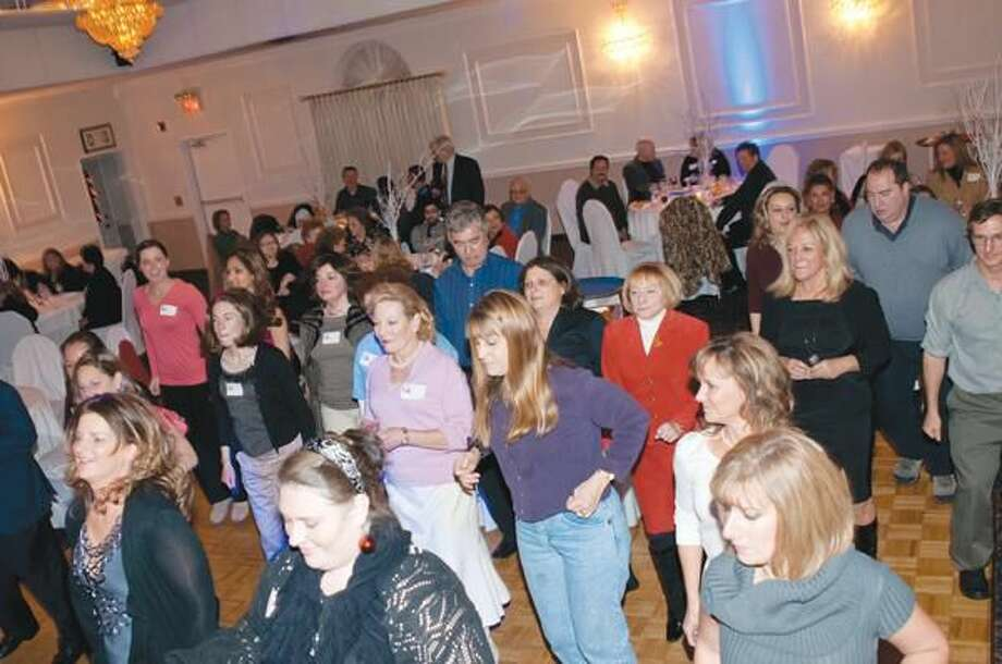 Submitted photo by Lifetiled Pictured are QChamber members dancing to music played by Firing Hot DJ Lou Ferraro from Lifetiled.