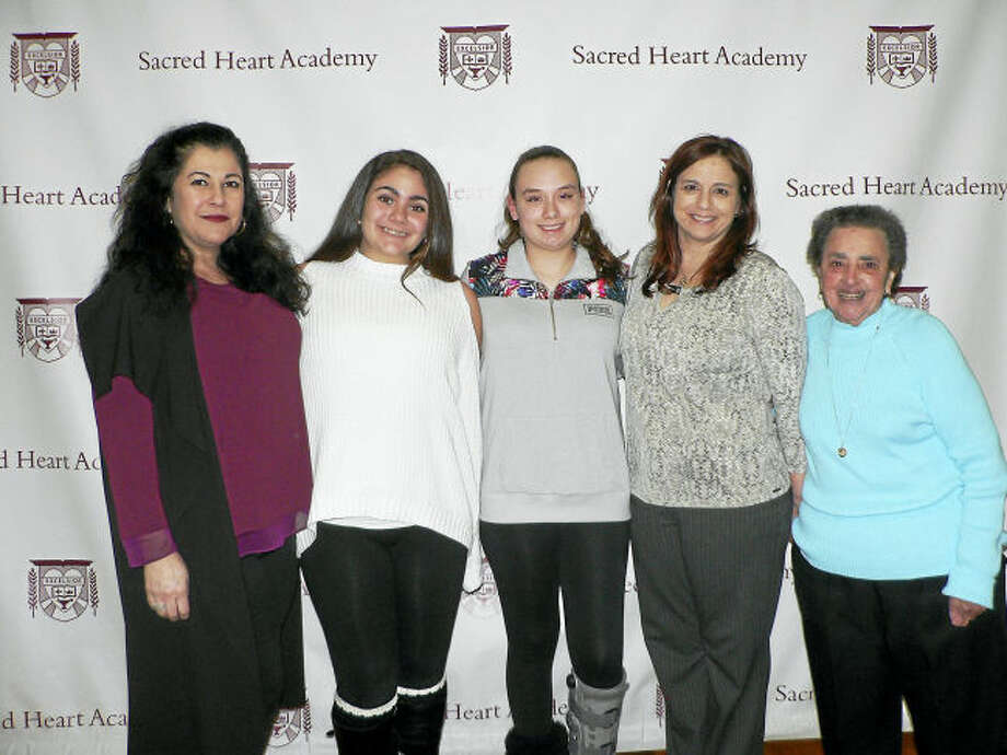 Contributed photo From left, North Haven residents Talia Bellucci '21 with her mother SallyAnn Esposito Bellucci '87 and Mia Willette '21 with her mother Anita DeLucia '87 and grandmothter Anna Marsico DeLucia '51.