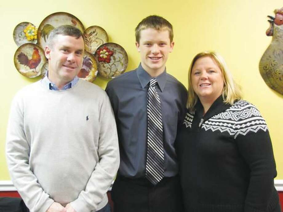 Submitted photos courtesy of David Marchesseault, Rotary Secretary December's Student of the Month, Spencer Oakes, stands with his parents, David and Nancy Oakes.