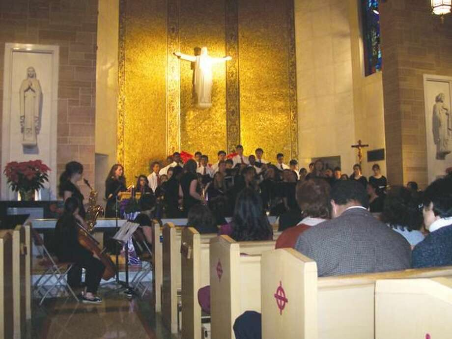 """Photo by Lynn Fredricksen Students from Sacred Heart Academy perform """"A Community Festival of Lessons and Carols"""" in the Chapel Sunday, Dec. 12."""