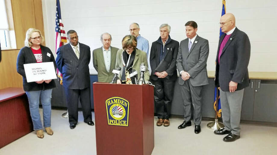 Hamden Police Chief Thomas Wydra and area gun control supporters joined U.S. Rep. Rosa DeLauro, D-3, Monday morning to voice opposition to a bill that would reform the process of obtaining a silencer.