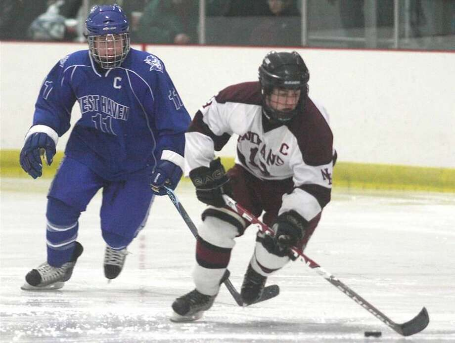 Photo by Russ McCreven North Haven captain Paul Donovan breaks away from West Haven captain Ryan Hansen in the Westies' 4-0 victory last Thursday afternoon at the Northford Ice Pavilion.