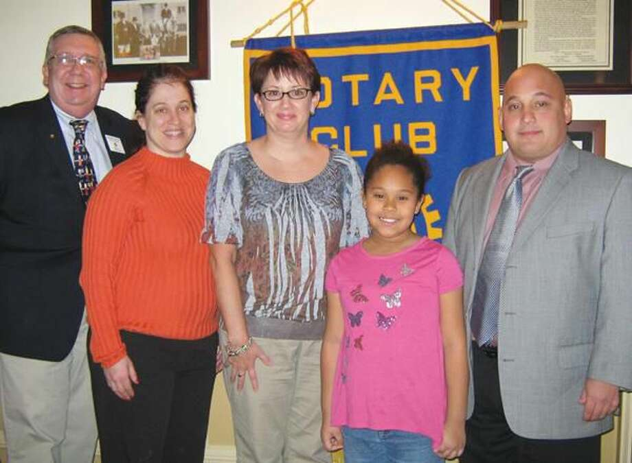 Submitted Photo Pictured left to right, Rotary Club President Richard Miller, second-grade teacher Liz McKiernan, fourth-grade teacher Charlotte Brombacker, Student of the Month Kayla Mims, and Church Street School principal Howard Hornreich.
