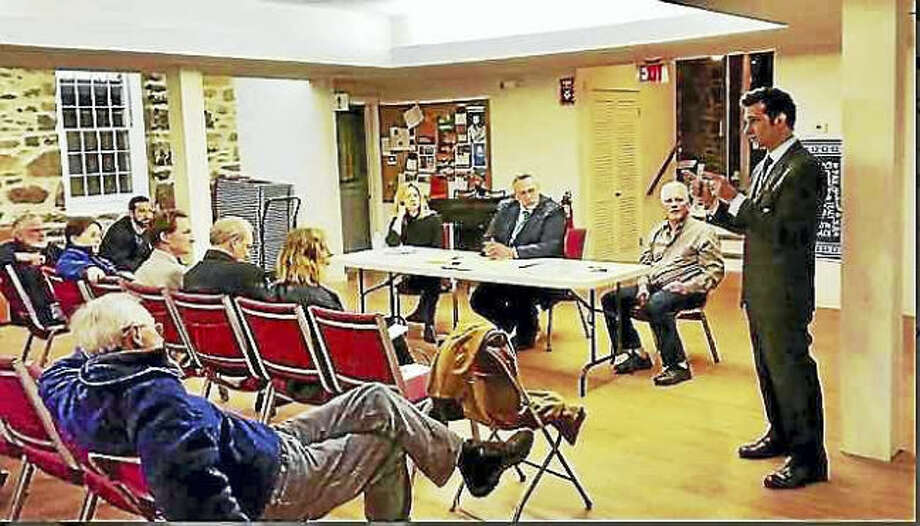 Kate Ramunni —New Haven Register State Rep. Michael D'Agostino, D-Hamden, speaks to residents living in the area of Whitneyville Thursday night at a forum with Mayor Curt Balzano Leng addressing the increases in their property assessments during the last revaluation.
