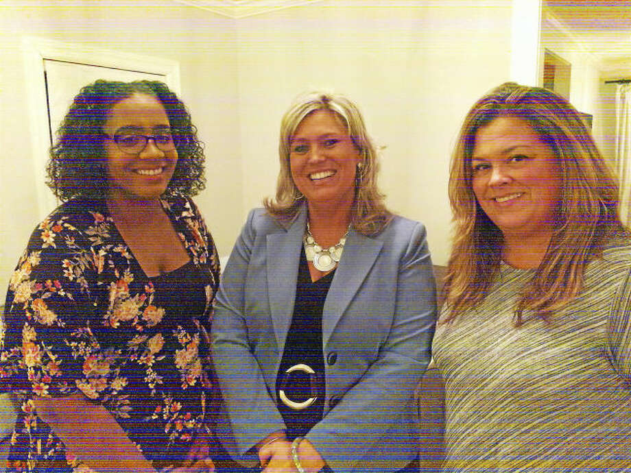 Photo by Jarret Liotta From left, Sheena Infante-Davis of Hamden, who was in foster care growing up; Jacque Ford, statewide foster care and adoption specialist; and Sarah Demerchant of Meriden, a foster parent.