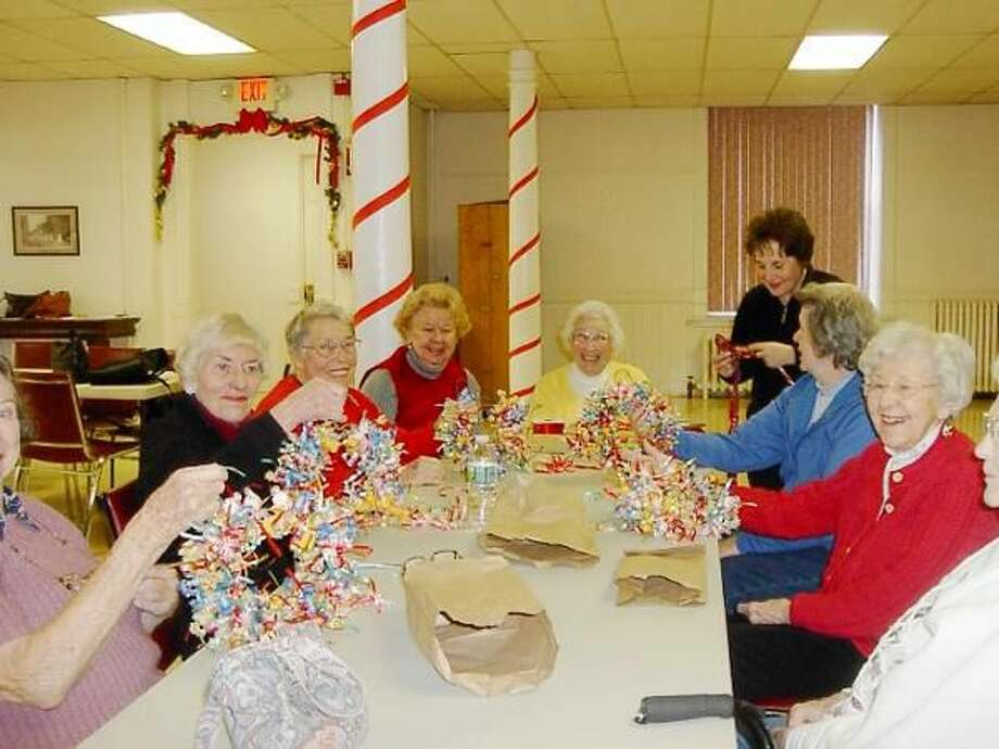 Submitted Photo Left to right are Carolyn Heine, Annette Adamec, Helen Daney, Betty Harkin, Rose Northrop, Fran Pellegrino, and Jean Stearns working on holiday wreaths made entirely of candy.