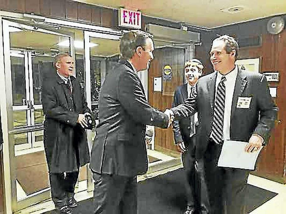 Brian Zahn — New Haven Register U.S. Sen. Chris Murphy is greeted at Congregation Mishkan Israel Friday by his friend, Mishkan Israel board member Joel Rudikoff.