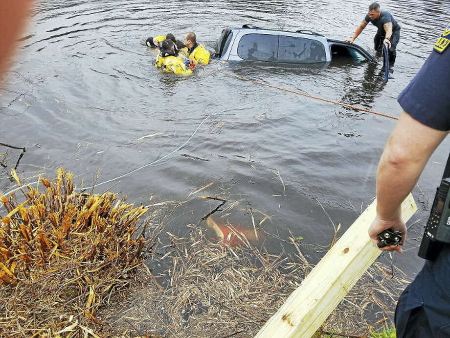 One person was rescued Thursday morning from a van in Lake Whitney in Hamden.