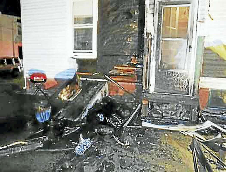 Courtesy of Hamden Fire Department. The Hamden Fire Department responded to 34 Second St. for a three-family home with the exterior on fire on Tuesday morning.