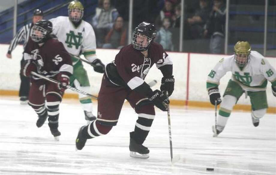 Photo by Russ McCreven North Haven's Andrew Babbidge controls the puck against Notre Dame.