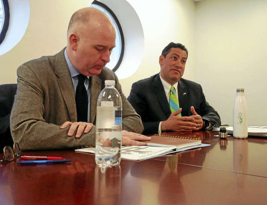 Connecticut Green Bank President and CEO Bryan Garcia, left, and Craig Connolly, Green Bank marketing director, speak to the Register editorial board.
