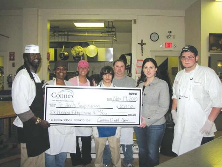 Submitted Photo Luqman Abdus-Salam, St. Ann's Soup Kitchen manager (left) and Amy Stanton, assistant vice president of marketing at Connex Credit Union (second from right) are joined by St. Ann's Soup Kitchen staff and volunteers.