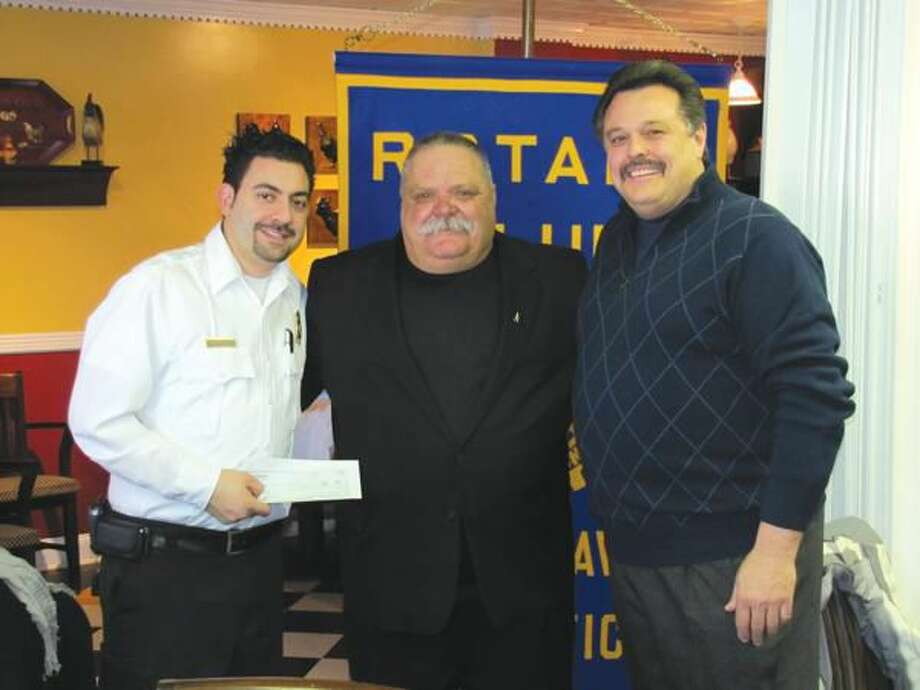 Submitted photo by David Marchesseault, Rotary Secretary Left to right, North Haven Rotarian Mark Lesage hands check to St Jude Hospital spokesman, Arthur Nataliano, accompanied by President-Elect Guy Casella.