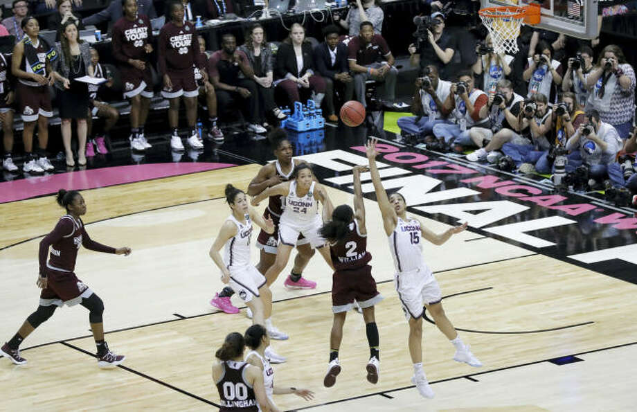 Mississippi State guard Morgan William (2) shoots the winning shot against UConn during Friday's national semifinal at the Final Four in Dallas. Mississippi State won 66-64 in overtime.