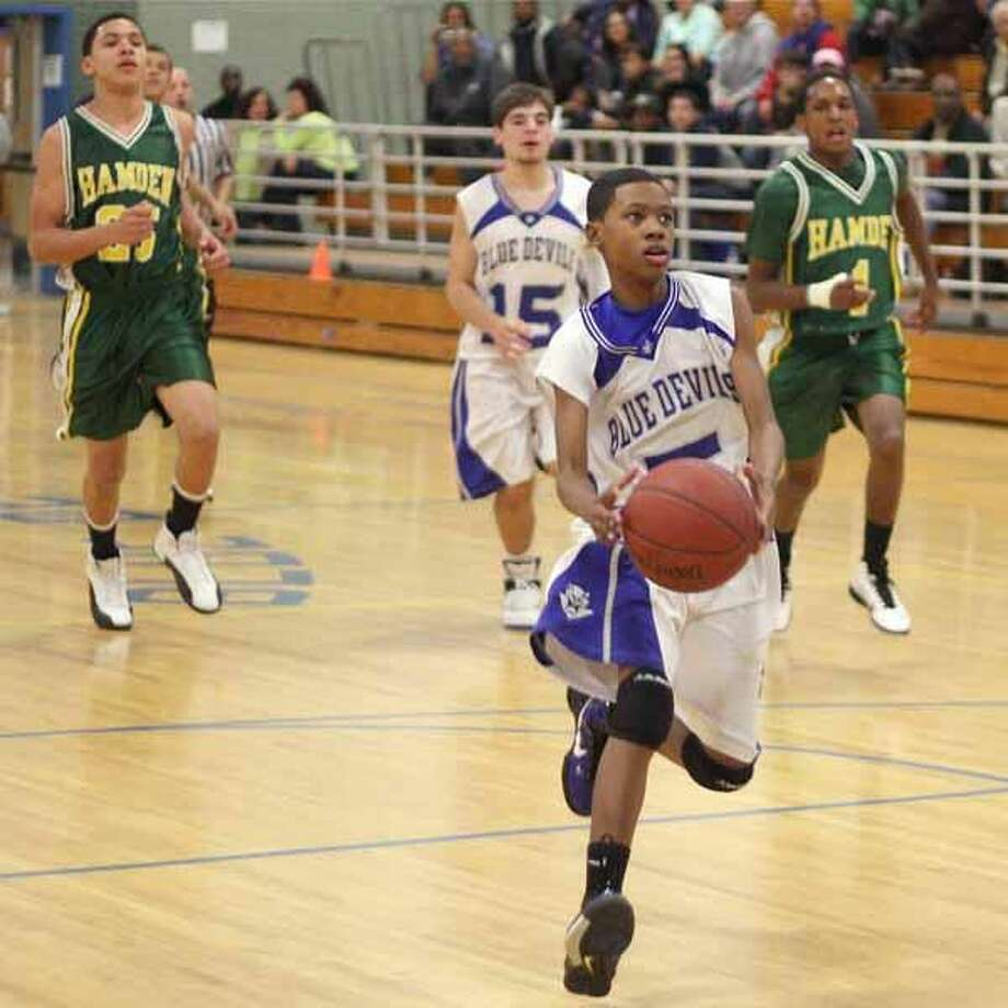 Photo by Russ McCreven West Haven's Tahji Eddy breaks away from the pack en route to a layup.